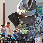 """Young helpers help sort and recycle Scrappy's trash so he is ready for a new """"skin"""" of trash attached during the 2014 RiverFest."""